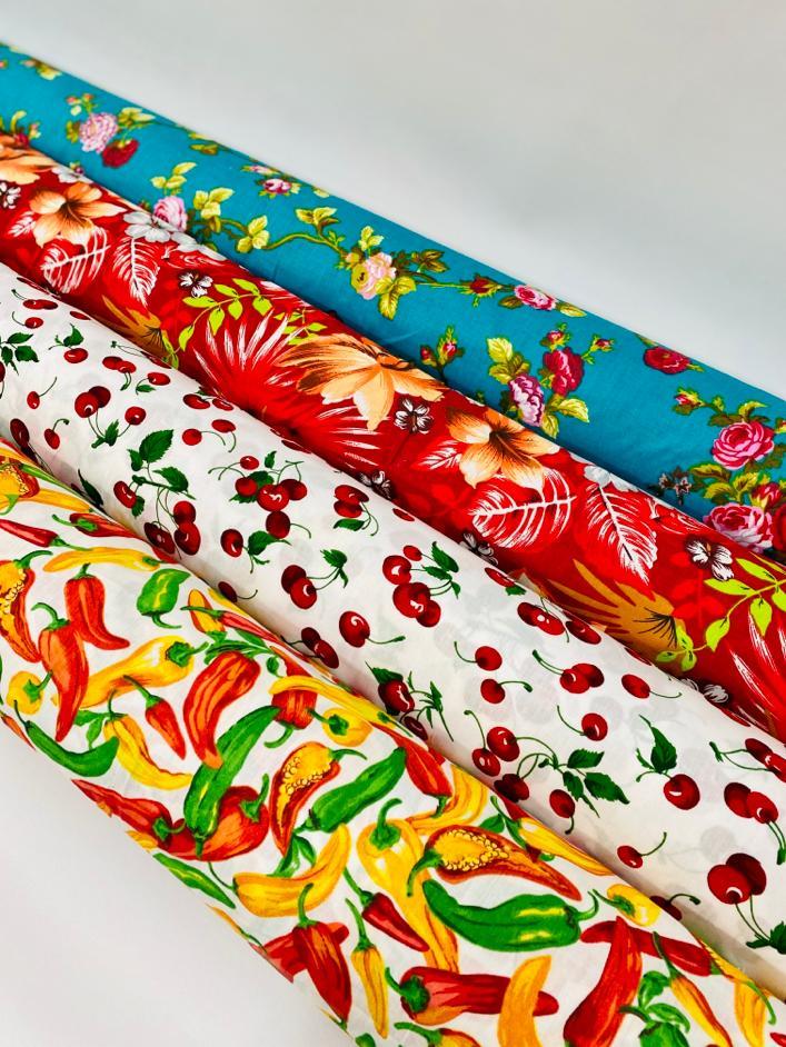 four rolls of fabric