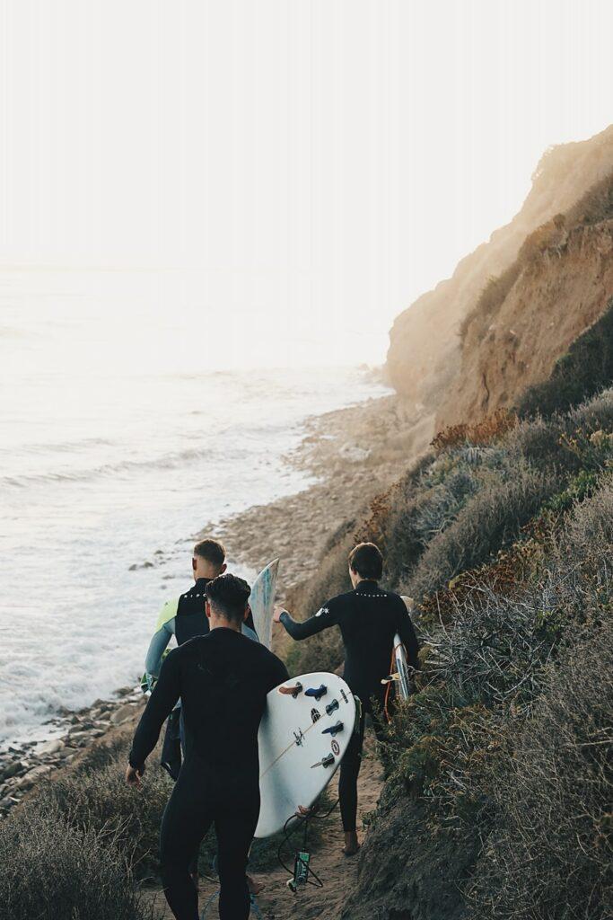 three men surfing