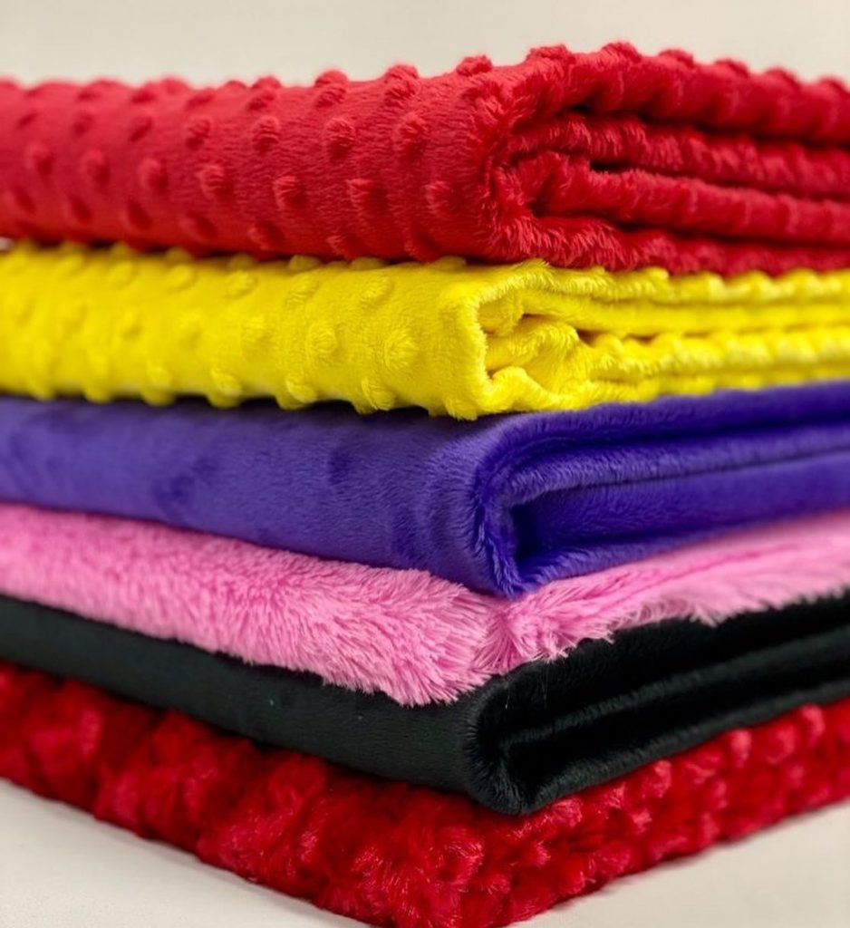 stack of minky fabrics